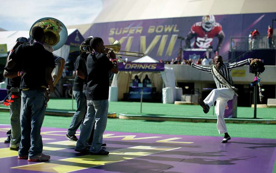 Darryl Young of New Orleans performs outside the Superdome before NFL Super Bowl XLVII.