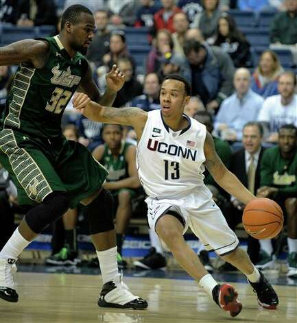 UConn's Shabazz Napier, right, drives past South Florida's Toarlyn Fitzpatrick during the first half of an NCAA college basketball game in Storrs, Conn., Sunday, Feb. 3, 2013. (AP Photo/Fred Beckham)
