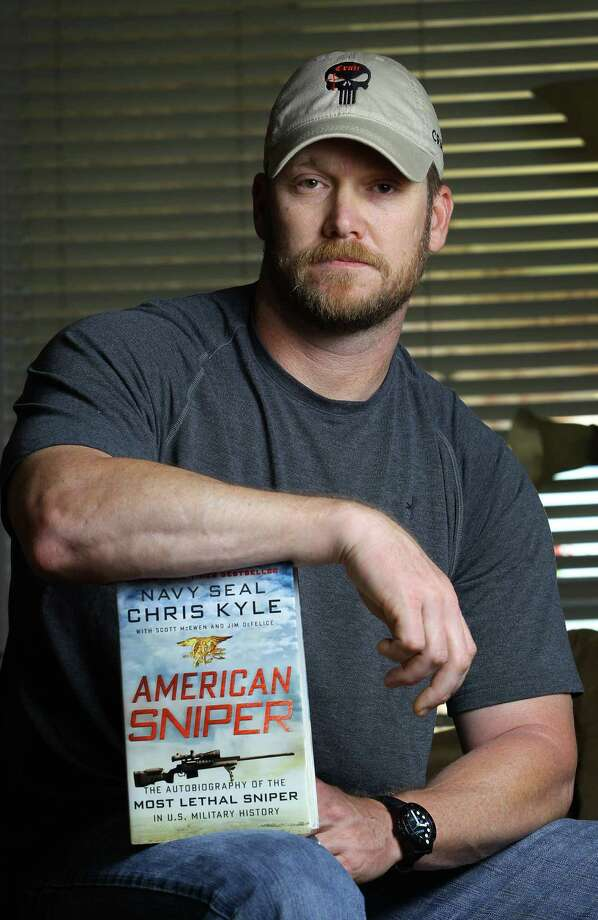 "In this April 6, 2012, photo, former Navy SEAL and author of the book ""American Sniper"" poses in Midlothian, Texas. A Texas sheriff has told local newspapers that Kyle has been fatally shot along with another man on a gun range, Saturday, Feb. 2, 2013. (AP Photo/The Fort Worth Star-Telegram, Paul Moseley) Photo: Paul Moseley"