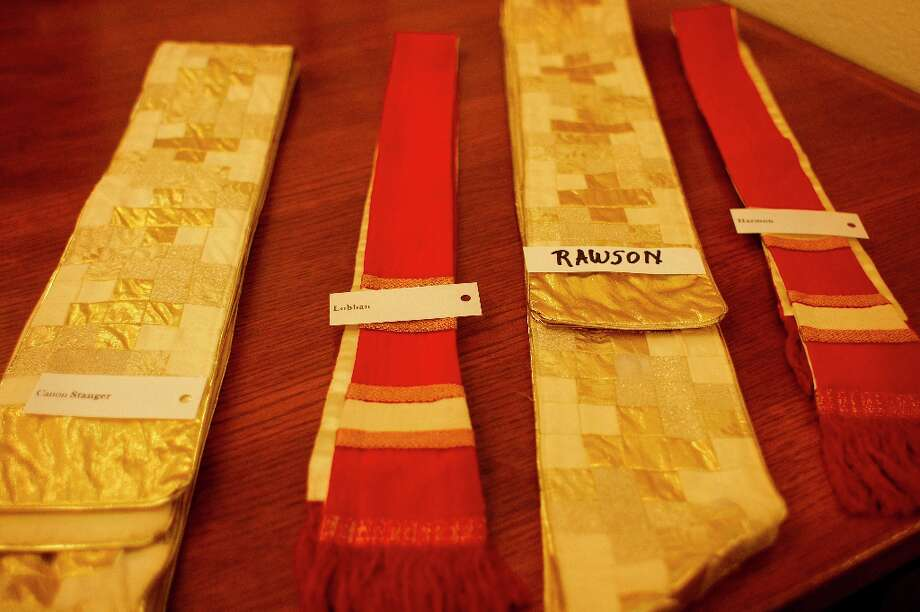 Red and gold vestments are laid out on a table before Sunday mass at the Grace Cathedral on Feb, 3. The clergy wore red and gold vestments in support of the San Francisco 49ers as they enter the Super Bowl today. Photo: James Tensuan, The Chronicle / ONLINE_YES