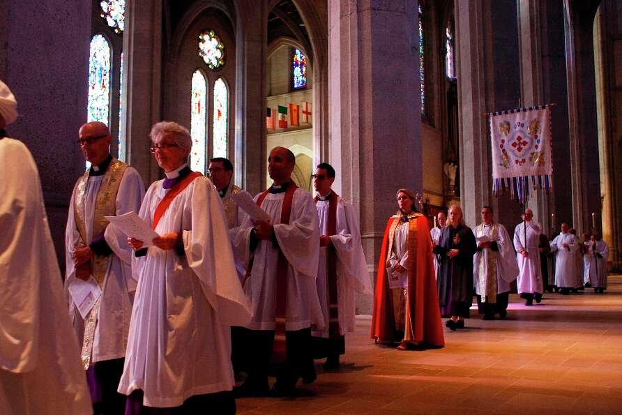 The Reverend Becca Stevens, in red, processes through the Grace Cathedral for Sunday mass on Feb. 3.