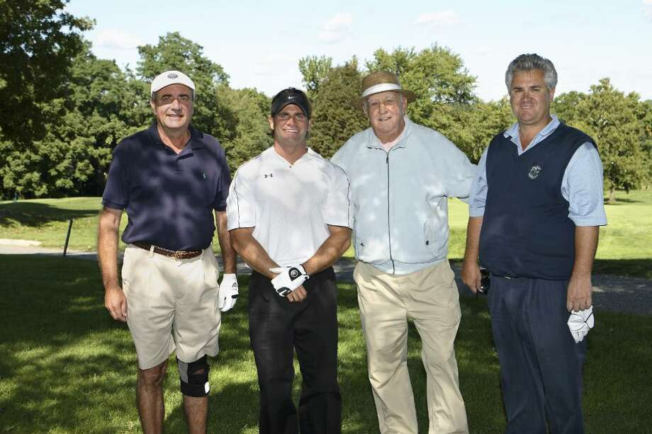Stratford resident, Ben Costello (second from right) who died Feb. 12 at the age of 85 was chairman of Bridgeport Hospital's Kaulbach Golf Classic for 28 years. The tournament has raised $750,000 for the hospital's Norma F. Pfriem Cancer Institute since 2000 alone. Pictured from left, William Woods of Trumbull, Jeffrey Woods of Huntington, Ben Costello, and Mill River Country Club Golf Professional Fred Kolakowski. Photo: Contributed Photo / Connecticut Post Contributed