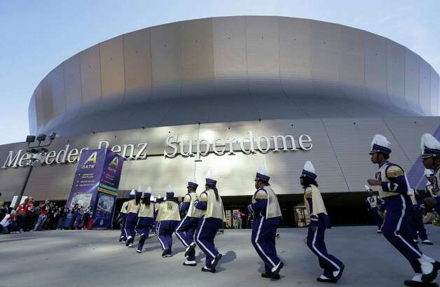 Members of the Warren Easton High School marching band of New Orleans perform outside of the Superdome before the NFL Super Bowl XLVII football game between the San Francisco 49ers and the Baltimore Ravens. Photo: Elaine Thompson, Associated Press / AP