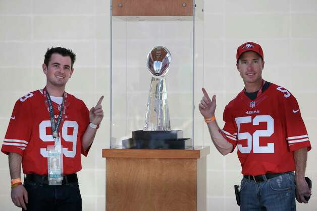 John McMillan from Las Vegas, left, and Frank Keith from Phoenix pose next to the Vince Lombardi Trophy. Photo: Elaine Thompson, Associated Press / AP
