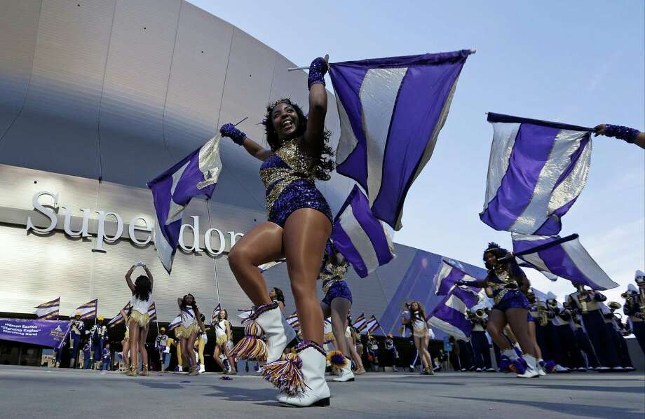 The band fires up the fans. Photo: Elaine Thompson, Associated Press / AP