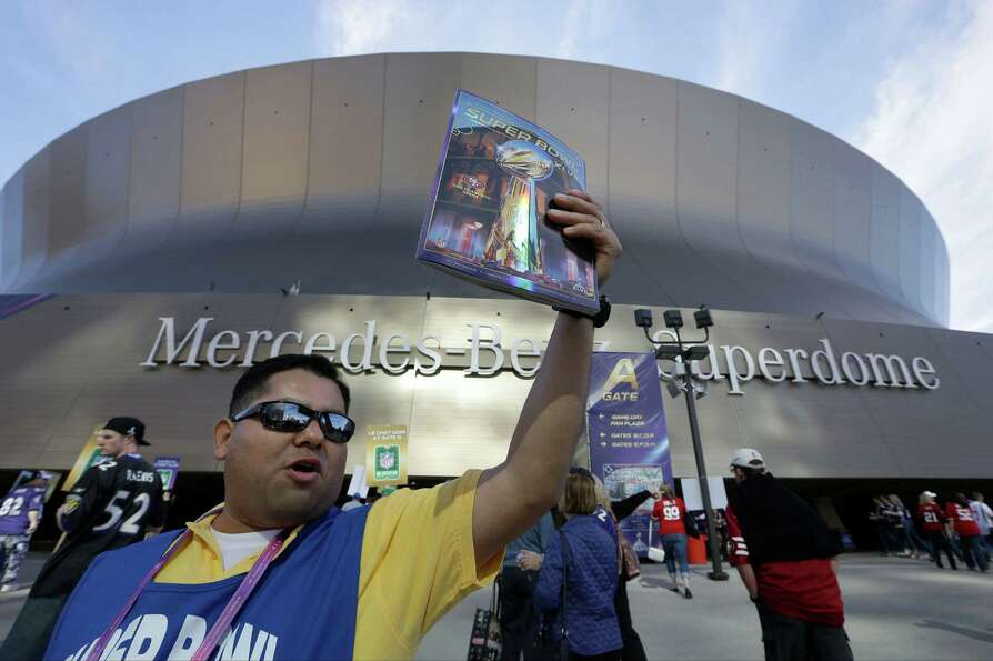 Jose Rodriguez, of Madera, Calif., sells programs outside of the Superdome.