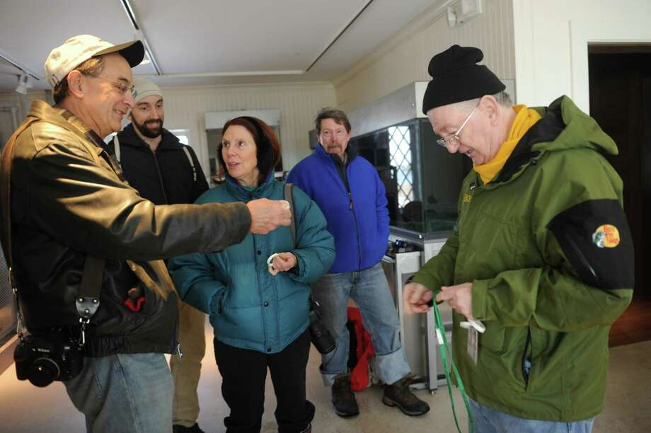 From left: Alan Scuterud,Jeff Hunter, a woman who didn't want to be indentified, Steve Kinner, and Bill Cameron, of Shellfish Commisson, in a class on clams at Innis Arden Cottage in Greenwich Point, Sunday, Feb. 3, 2013.Town Conservation Director Denise Savageau speaks of the historic flooding including water levels and storm surge throughout the open house. Additionally, members of the Friends of Greenwich Point and the Greenwich Point Conservancy give an update on repair and restoration activities. This event is hosted by the Friends of Greenwich Point, the Greenwich Point Conservancy the Shellfish Commission, and the Town of Greenwich Conservation Commission. Photo: Helen Neafsey / Greenwich Time