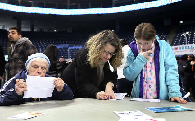Judges, from left,  Beatrice Krawieski, Katrina Schmier, 11, and her mother, Cynthia Potter, all of Norwalk, fill in their favorite soups at Chowda Fest at Webster Bank Arena in Bridgeport , Conn. on Sunday, February 3, 2013.  The Unitarian Church in Westport sponsors the event, which raises money for the Connecticut Food Bank. Photo: BK Angeletti, B.K. Angeletti / Connecticut Post freelance B.K. Angeletti