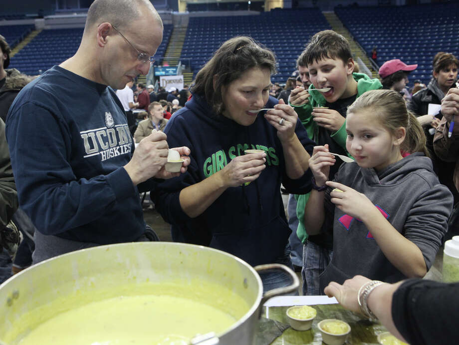 Members of the Poisson family, from left, Ken, Barb, Ryan, 12, and Susie, 10, of Stratford, taste soup during Chowda Fest at Webster Bank Arena in Bridgeport , Conn., on Sunday, February 3, 2013.  The Unitarian Church in Westport sponsors the event, which raises money for the Connecticut Food Bank. Photo: BK Angeletti, B.K. Angeletti / Connecticut Post freelance B.K. Angeletti