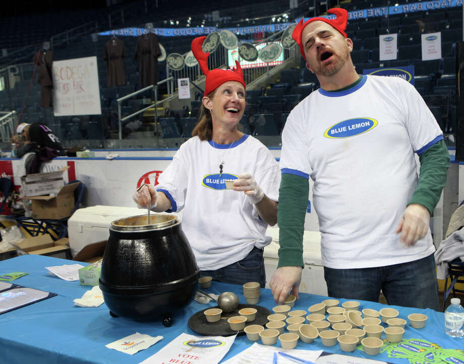 Cindy DeNatale and Jeff Evans offer lobster bisque from the Blue Lemon, of Westport, during Chowda Fest at Webster Bank Arena in Bridgeport , Conn., on Sunday, February 3, 2013.  The Unitarian Church in Westport sponsors the event, which raises money for the Connecticut Food Bank. Photo: BK Angeletti, B.K. Angeletti / Connecticut Post freelance B.K. Angeletti