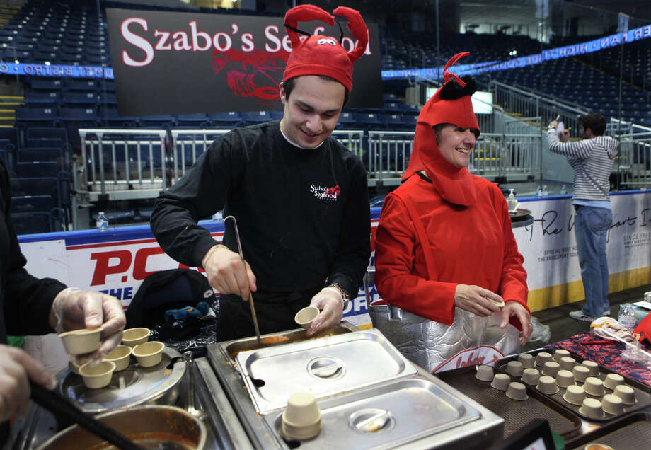 Mike Szabo and his mother Cathy, of Shelton,  offer Manhattan clam chowder during Chowda Fest at Webster Bank Arena in Bridgeport , Conn., on Sunday, February 3, 2013.  The Unitarian Church in Westport sponsors the event, which raises money for the Connecticut Food Bank. Photo: BK Angeletti, B.K. Angeletti / Connecticut Post freelance B.K. Angeletti
