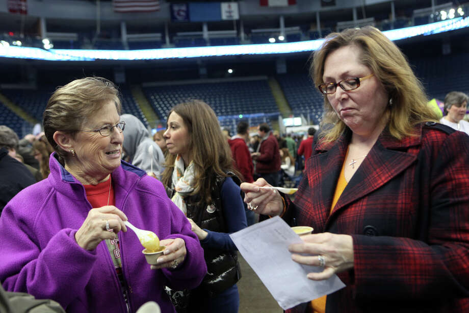 Lee Chizmadia, of Brookfield, , left, and Jill Newman, of Milford,  taste soup during Chowda Fest at Webster Bank Arena in Bridgeport , Conn., on Sunday, February 3, 2013.  The Unitarian Church in Westport sponsors the event, which raises money for the Connecticut Food Bank. Photo: BK Angeletti, B.K. Angeletti / Connecticut Post freelance B.K. Angeletti