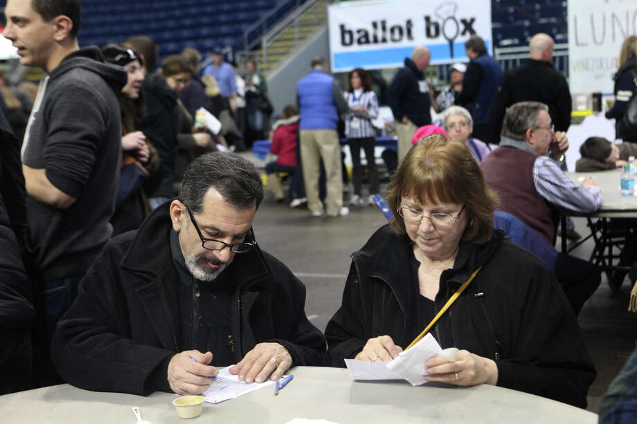 John and Susan Weisheil, of Norwalk, pick their favorite soups at Chowda Fest on Sunday, February 3, 2013 at Webster Bank Arena in Bridgeport , Conn.  The Unitarian Church in Westport sponsors the event, which raises money for the Connecticut Food Bank. Photo: BK Angeletti, B.K. Angeletti / Connecticut Post freelance B.K. Angeletti