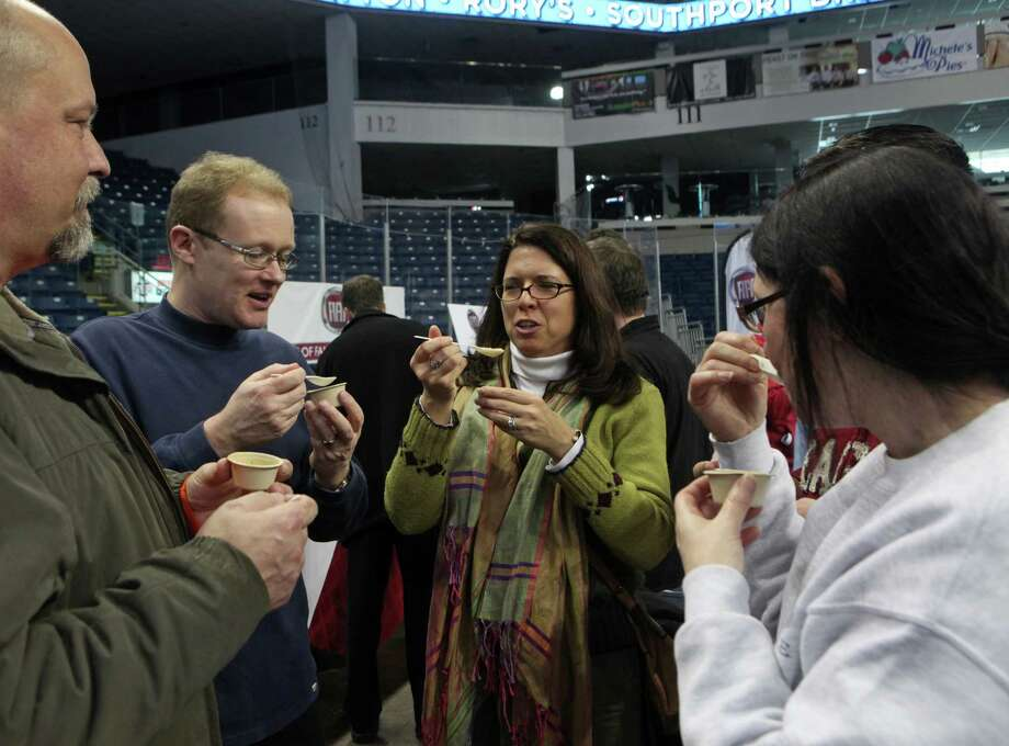 Judges, from left , Jim Upton, of Redding, John Summerfield, of UK, Jennifer Upton, and Frances Summerfield,  taste soup during Chowda Fest at Webster Bank Arena in Bridgeport , Conn., on Sunday, February 3, 2013.  The Unitarian Church in Westport sponsors the event, which raises money for the Connecticut Food Bank. Photo: BK Angeletti, B.K. Angeletti / Connecticut Post freelance B.K. Angeletti