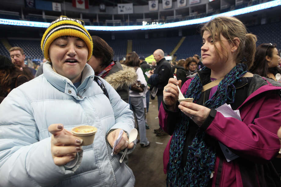 Joann Cito, of Monroe, and Jennifer Holecz, of Bridgeport,  taste soup during Chowda Fest at Webster Bank Arena in Bridgeport , Conn., on Sunday, February 3, 2013.  The Unitarian Church in Westport sponsors the event, which raises money for the Connecticut Food Bank. Photo: BK Angeletti, B.K. Angeletti / Connecticut Post freelance B.K. Angeletti