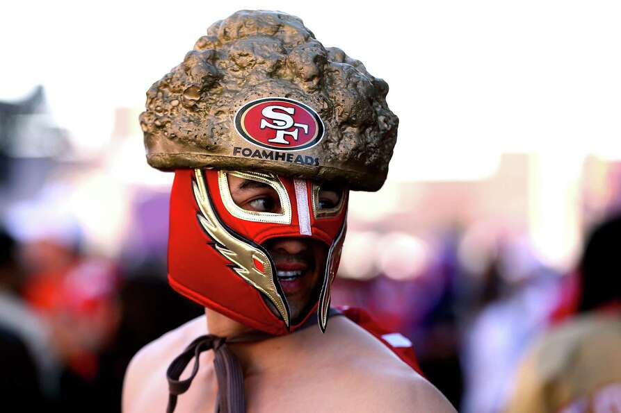 A San Francisco 49ers fan walks around outside the stadium.