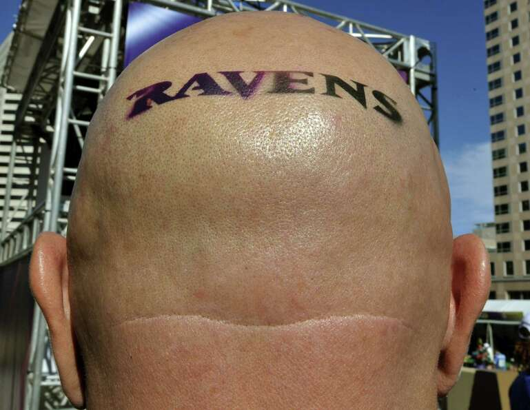 A Baltimore Ravens fan poses before the start of Super Bowl XLVII.