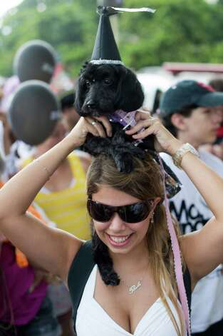 Awoman dances with her dog during the animals carnival, in Copacabana beach in Rio de Janeiro on Sunday. AFP PHOTO / CHRISTOPHE SIMON Photo: CHRISTOPHE SIMON, Getty / 2013 AFP