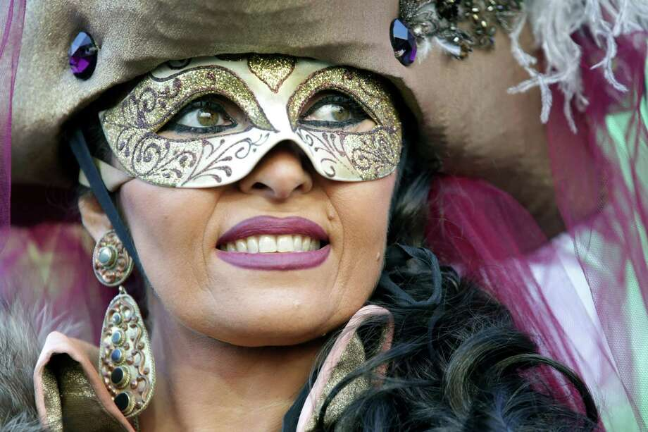 A woman dressed in costume performs on stage during the Volo dell'Angelo at the official Opening of Venice Carnival at Piazza San Marco on Monday in Venice, Italy. The Carnival which starts on February 2 and finishes on February 12, attracts thousands of tourists from all over the world. Photo: Barbara Zanon, Getty / 2013 Barbara Zanon