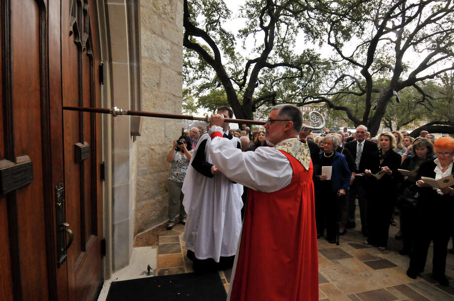The Right Rev. Gary Lillibridge knocks on the door to St. Mark's Episcopal Church to start the rededication ceremony Sunday, Feb. 3, 2013, following a $15 million renovation to the historic downtown church. Photo: Robin Jerstad, For The Express-News