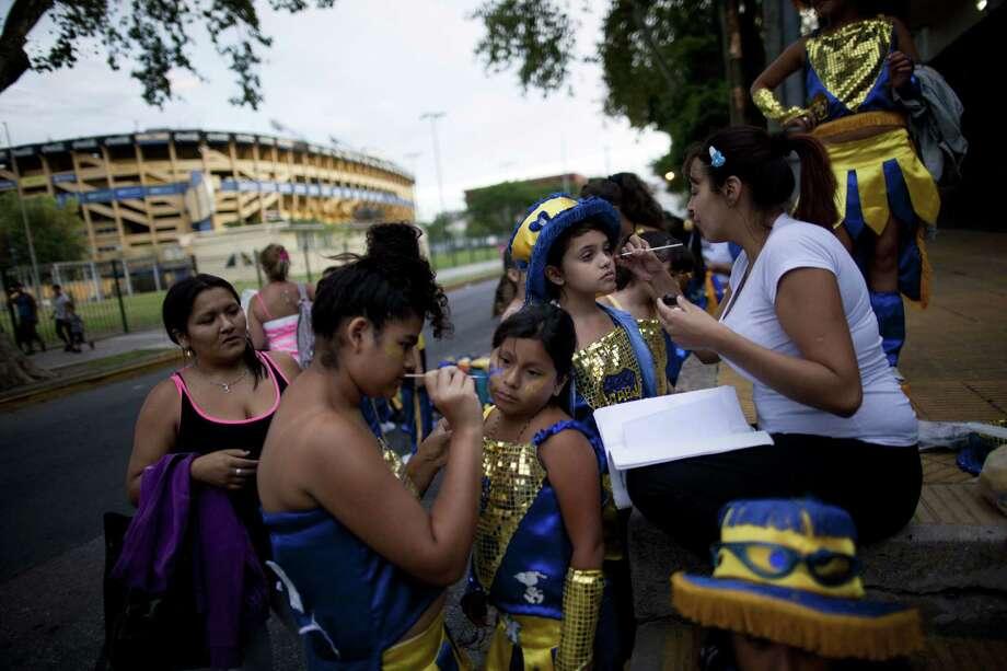 "Members of the murga ""Los amantes de La Boca"" prepare to participate in carnival celebrations in Buenos Aires, Argentina, Saturday. Photo: AP"