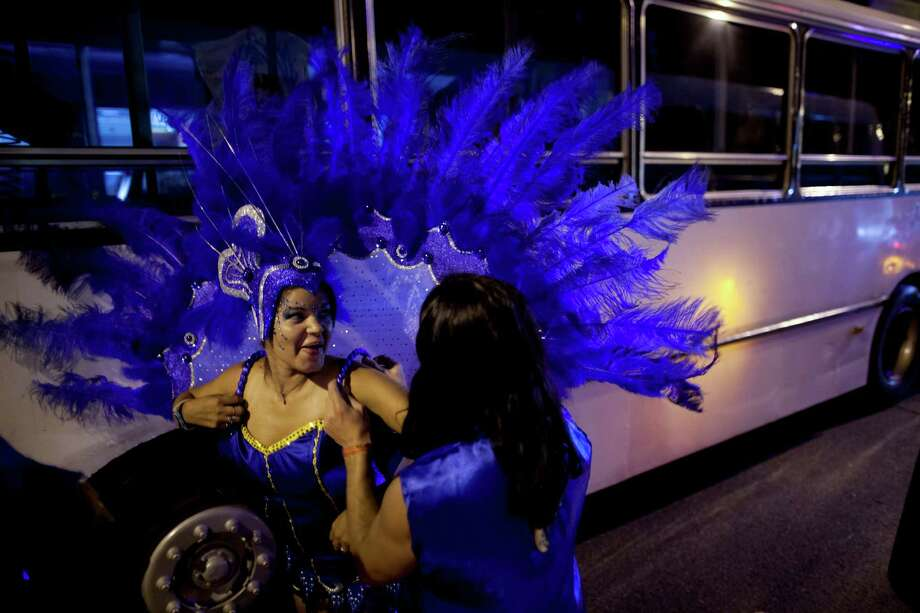 "Members of the murga ""Los amantes de La Boca"" prepare before participating in carnival celebrations in Buenos Aires, Argentina, Saturday. Photo: AP"