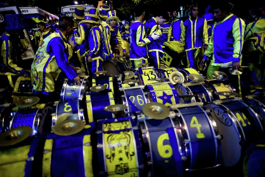 "Drummers of the murga ""Los amantes de La Boca"" prepare their instruments for carnival celebrations in Buenos Aires, Argentina, Saturday. Photo: AP"