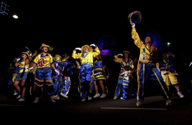 "Members of the murga ""Los amantes de La Boca"" perform during carnival celebrations in Buenos Aires, Argentina, Sunday. Photo: AP"