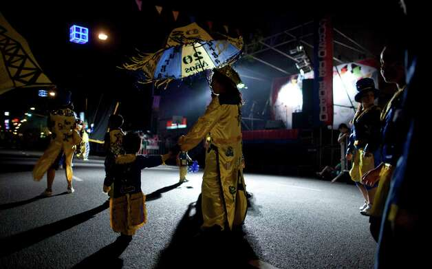 "Members of the murga ""Los amantes de La Boca"" perform during carnival celebrations in Buenos Aires, Argentina, Saturday. Photo: AP"