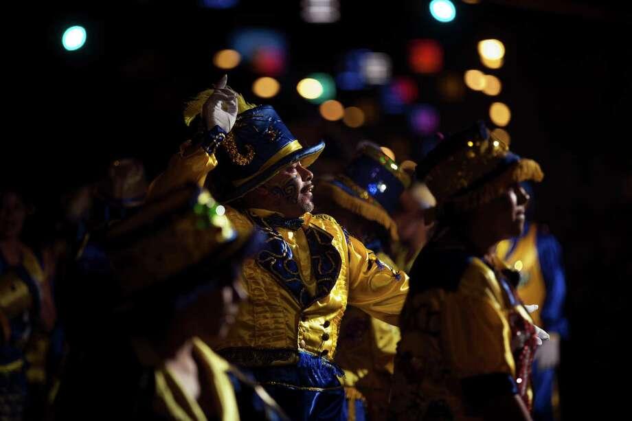 "Members of the murga ""Los amantes de La Boca"" perform during carnival celebrations in Buenos Aires, Argentina, Saturday. Photo: AP"