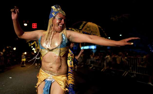 "A member of the murga ""Los amantes de La Boca"" performs during carnival celebrations in Buenos Aires, Argentina, Saturday. Photo: AP"