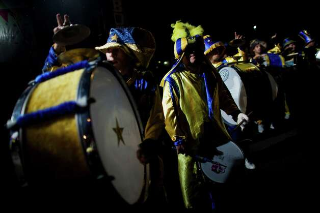 "Drummers of the murga ""Los amantes de La Boca"" perform during carnival celebrations in Buenos Aires, Argentina, Saturday. Photo: AP"