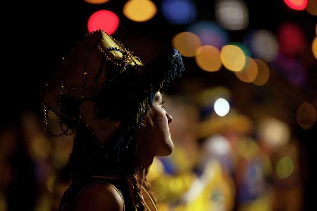 "A member of the murga ""Los amantes de La Boca"" participates in carnival celebrations in Buenos Aires, Argentina, Saturday. Photo: AP"