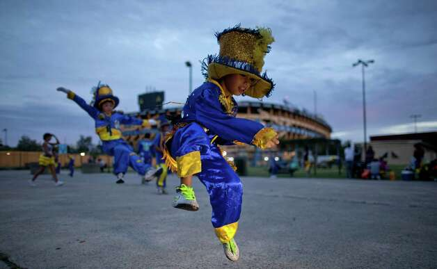 "Members of the murga ""Los amantes de La Boca"" rehearse before participating in carnival celebrations in Buenos Aires, Argentina, Saturday. Photo: AP"