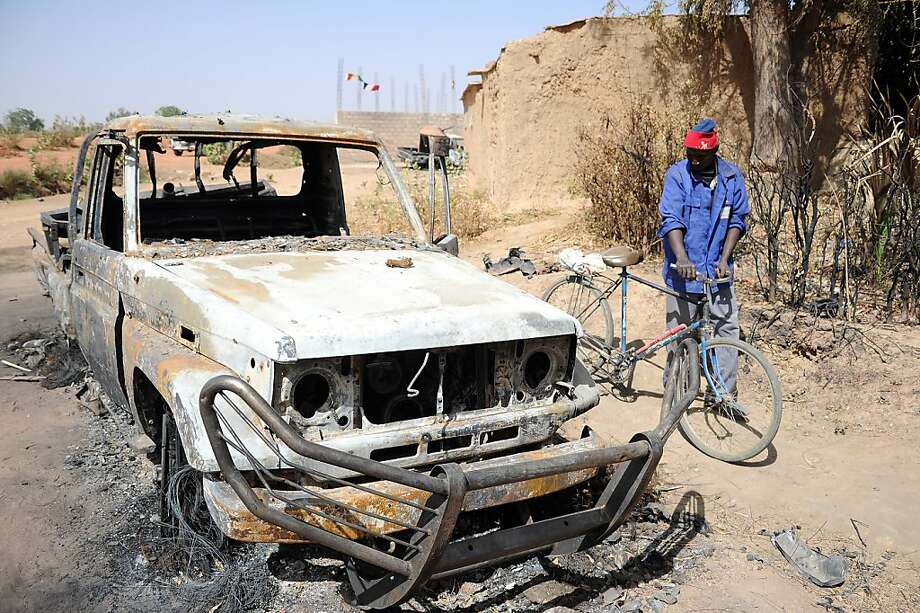 A vehicle reportedly used by Islamic militants is burned out after a French air strike in Diabaly, Mali. The French targeted some 20 sites in the north, near the Algeria border. Photo: Pascal Guyot, AFP/Getty Images