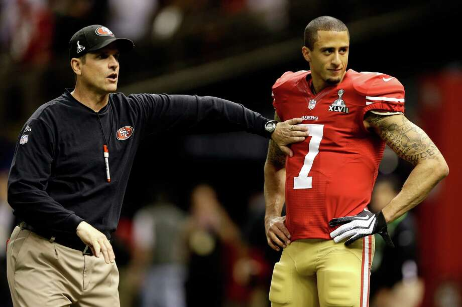NEW ORLEANS, LA - FEBRUARY 03: Head coach Jim Harbaugh taps  Colin Kaepernick #7 of the San Francisco 49ers on the chest during warm ups prior to Super Bowl XLVII against the Baltimore Ravens at the Mercedes-Benz Superdome on February 3, 2013 in New Orleans, Louisiana. Photo: Ezra Shaw, Getty Images / 2013 Getty Images