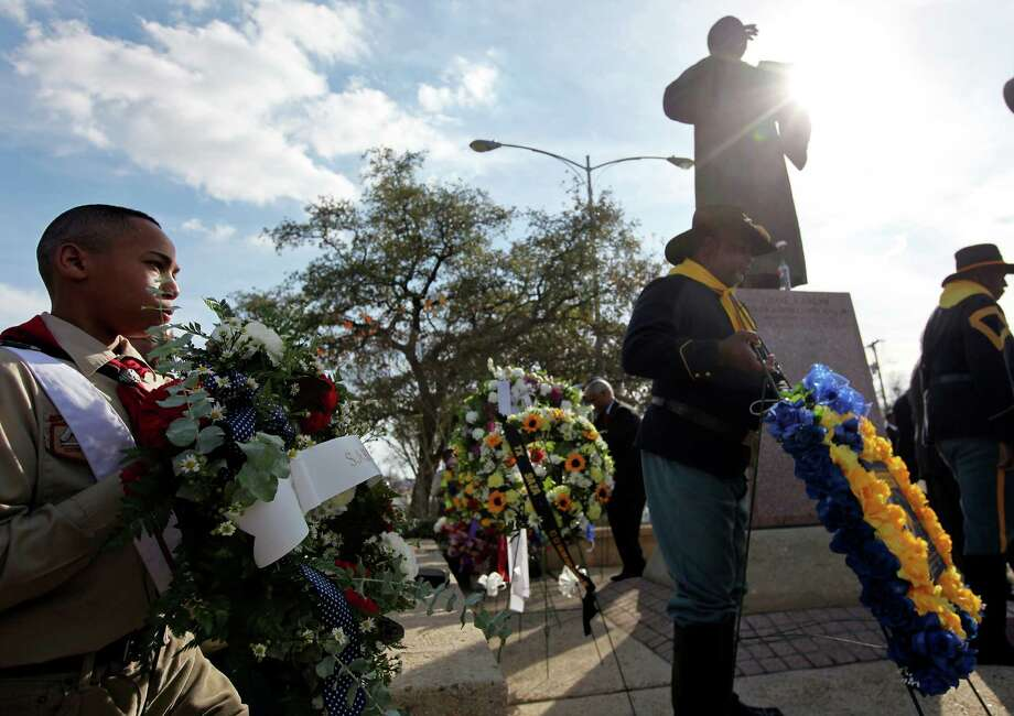 Bethel Ame Church Boy Scout Troop #96 scout Devon Slaughter, 12, (left) and others takes part in the 26th annual Rev. Dr. Martin Luther King, Jr. Wreath Laying Ceremony held Sunday Jan. 20, 2013 at MLK Plaza. Photo: Edward A. Ornelas, San Antonio Express-News / © 2012 San Antonio Express-News