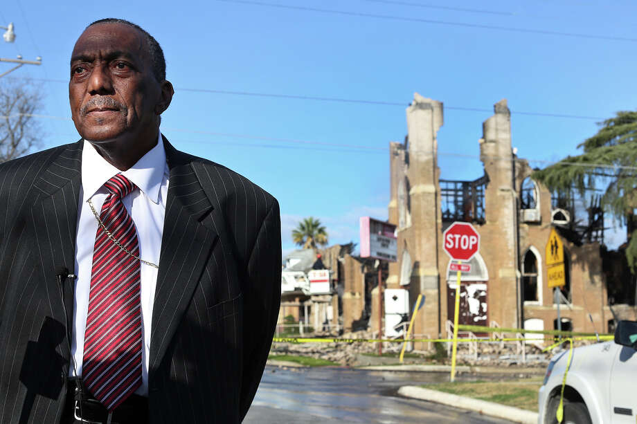 Bishop Samuel Iglehart, the pastor at Childress Memorial Church Of God In Christ, talks about the destruction of his church after an overnight multi-alarm fire in San Antonio on Saturday, Feb. 2, 2013. Photo: Lisa Krantz, San Antonio Express-News / © 2012 San Antonio Express-News