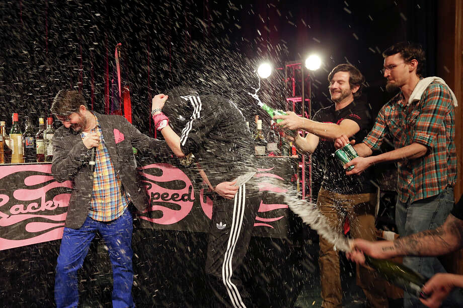 Esquire bar manager Karah Carmack (center under jacket) is sprayed after winning the Speed Rack competition Sunday Jan. 20, 2013 at the St. Anthony Hotel. Photo: Edward A. Ornelas, San Antonio Express-News / © 2012 San Antonio Express-News