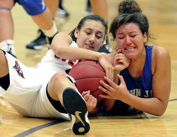 Stevens' Julia Rendon (left) struggles with Jay's Katelyn McCullar (right) for possession of the ball during girls basketball at Paul Taylor Fieldhouse on Saturday, Jan. 19, 2013. Jay defeated Stevens in overtime, 51-47. Photo: Kin Man Hui, San Antonio Express-News / © 2012 San Antonio Express-News