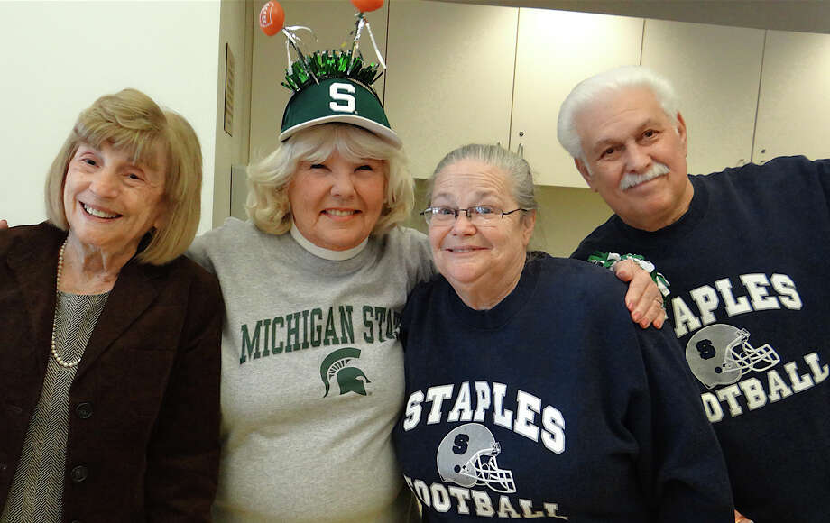 Jo Luscombe, Betty Lou Cummings, Toni Rubin and Stephen Rubin get in the spirit of the Super Bowl at the Westport Center for Senior Activities tailgate party for the community Sunday.  WESTPORT NEWS, CT 2/3/13 Photo: Mike Lauterborn / Westport News contributed