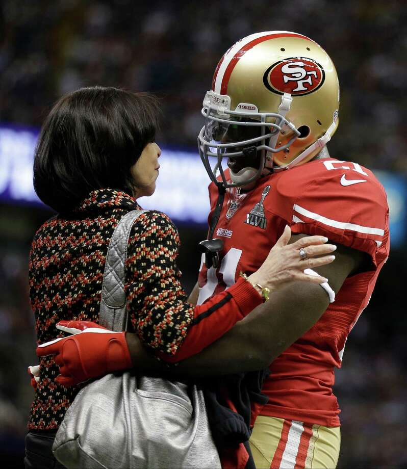 San Francisco 49ers co-chair Denise York, left, talks to running back Frank Gore, right, before the NFL Super Bowl XLVII football game against the Baltimore Ravens, Sunday, Feb. 3, 2013, in New Orleans. (AP Photo/David Goldman) Photo: David Goldman, Associated Press / AP
