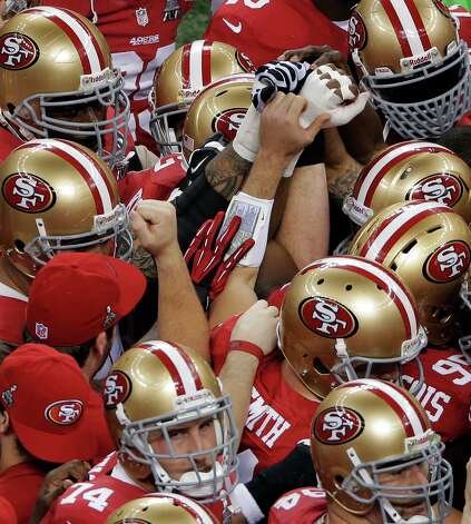 San Francisco 49ers players huddle before the NFL Super Bowl XLVII football game against the Baltimore Ravens, Sunday, Feb. 3, 2013, in New Orleans. (AP Photo/Charlie Riedel) Photo: Charlie Riedel, Associated Press / AP
