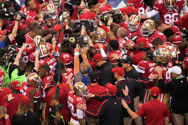The San Francisco 49ers huddle around inside linebacker Patrick Willis (52), facing at top left, before Super Bowl XLVII. Photo: Smiley N. Pool / © 2013  Houston Chronicle