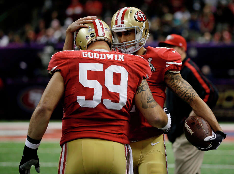 San Francisco 49ers center Jonathan Goodwin (59) and quarterback Colin Kaepernick hug during warmups. Photo: Matt Slocum
