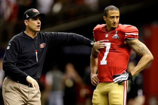 San Francisco 49ers coach Jim Harbaugh and quarterback Colin Kaepernick speak during warmups.