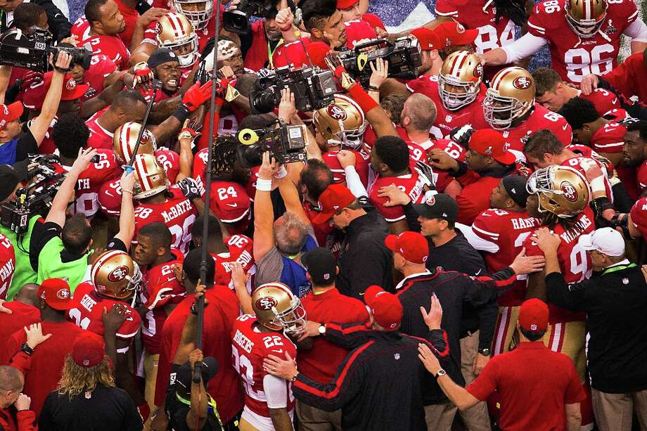 The San Francisco 49ers huddle around inside linebacker Patrick Willis (52), facing at top left, before Super Bowl XLVII at the Mercedes-Benz Superdome on Sunday, Feb. 3, 2013, in New Orleans. Photo: Smiley N. Pool, Chronicle / ONLINE_YES
