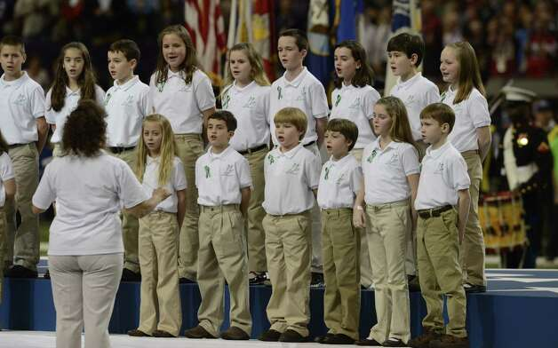 "Members of the Sandy Hook Elementary School Chorus sing ""America The Beautiful""  before Super Bowl XLVII between the San Francisco 49ers and the Baltimore Ravens at the Mercedes-Benz Superdome on February 3, 2013 in New Orleans, Louisiana. TIMOTHY A. CLARY/AFP/Getty Images Photo: TIMOTHY A. CLARY, Getty Images / AFP"