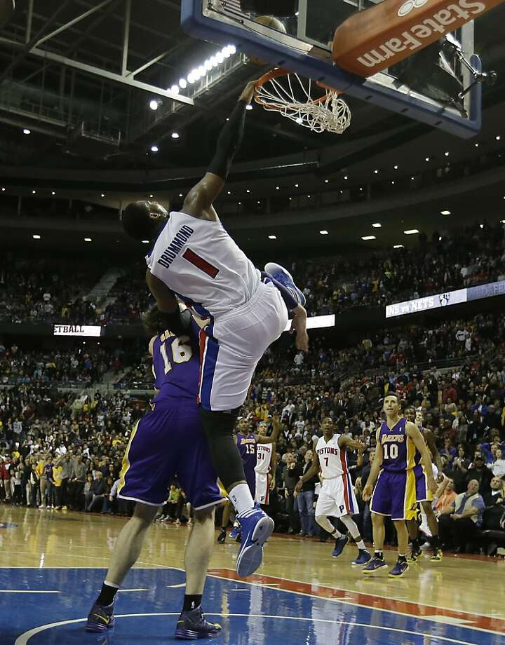Pistons center Andre Drummond, defended by the Lakers' Pau Gasol, can't connect on an alley-oop-attempt at the end of the one-point loss. Photo: Carlos Osorio, Associated Press