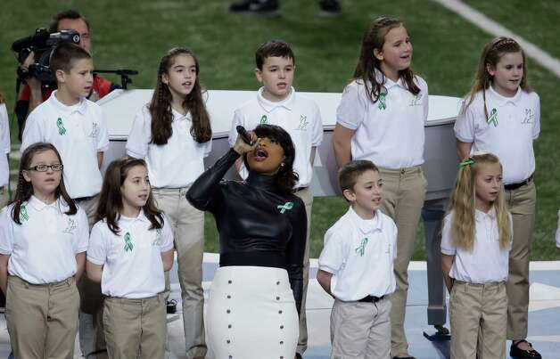 "Jennifer Hudson performs with students from Sandy Hook Elementary School singing ""America the Beautiful"" before NFL Super Bowl XLVII football game between the San Francisco 49ers and the Baltimore Ravens Sunday, Feb. 3, 2013, in New Orleans. (AP Photo/Gerald Herbert) Photo: Gerald Herbert, AP / Associated Press"